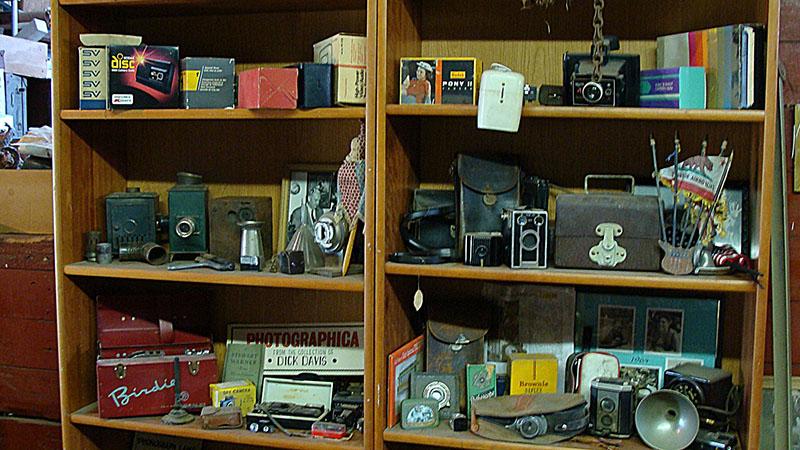 Cameras and Shelves of Gear